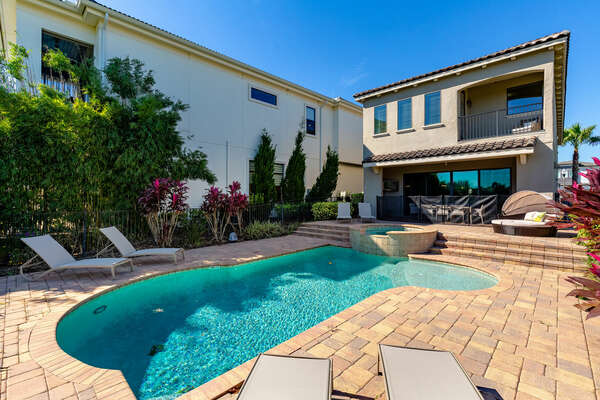 Enjoy the Florida sun in your private pool with spillover spa