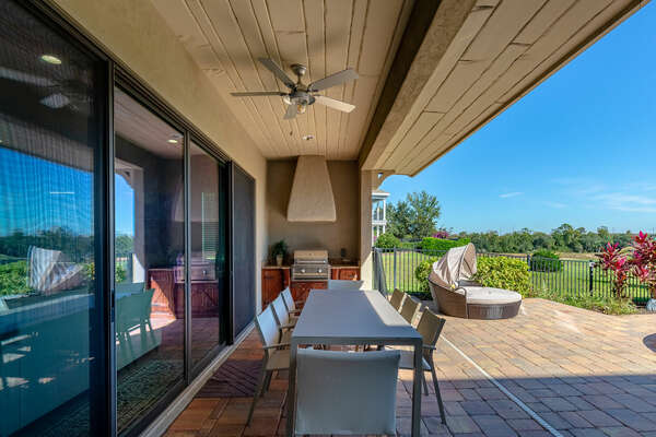 The lanai features a built-in BBQ and outdoor dining for 8
