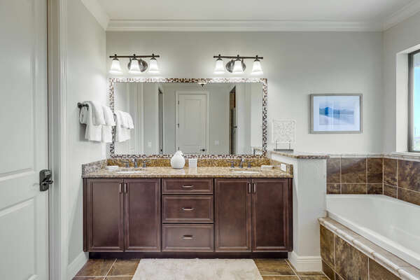 The ensuite has private access to the patio and a large walk-in shower