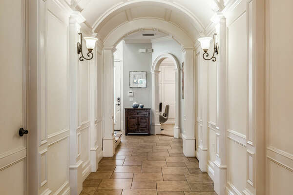 Walk through the beautiful arched foyer to see what the home has in store