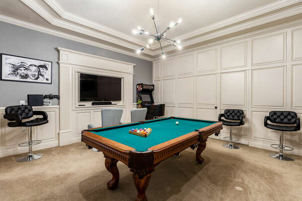 Your very own Billiard room with a 60-inch SMART TV, Multi Arcade system, PS4, Apple TV 2, and board games