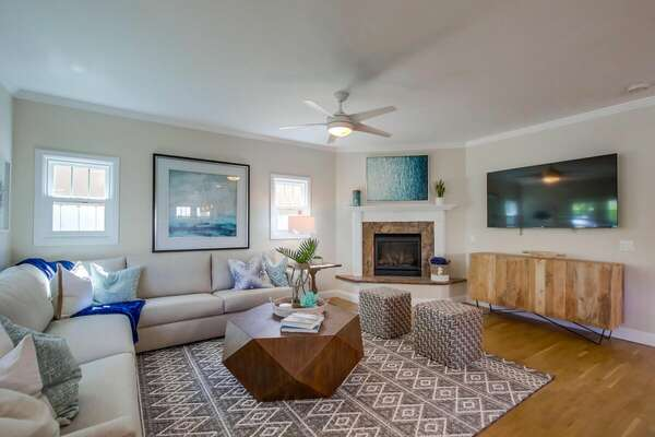 Spacious living room with fireplace & smart TV