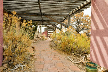 Property and exterior views showing desert landscaping.