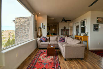 Living space with a view and a sectional couch