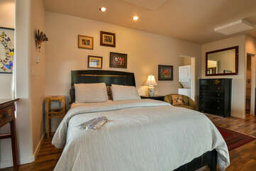 Bedroom with a queen bed and dresser