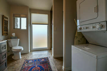 Bathroom and laundry with a washer and dryer