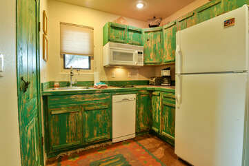 Unique kitchen of this Moab place to stay, with a green color scheme and modern amenities.