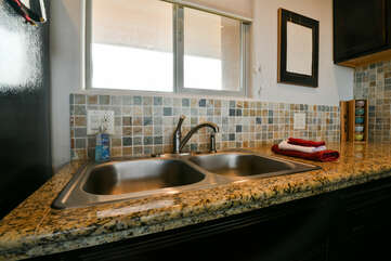 Fully-equipped kitchen with a double sink