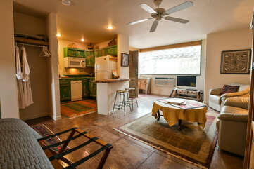 Kitchen, living space, and sleeping area. Full view of the Moab place to stay studio space.