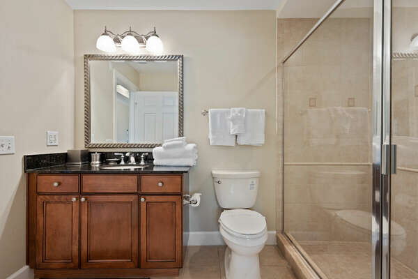 The ensuite bathroom has a large step-in shower