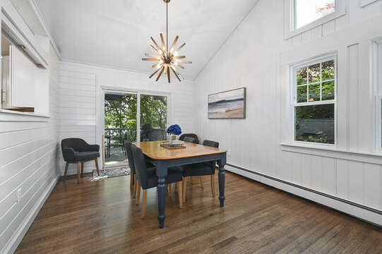 Dining room with high ceiling and sliders to the deck - 46 Holly Point Road Centerville Cape Cod