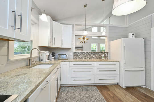 Modern kitchen with open access to dining area - 46 Holly Point Road Centerville Cape Cod