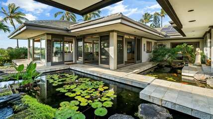 Courtyard with Koi pond leading into the home