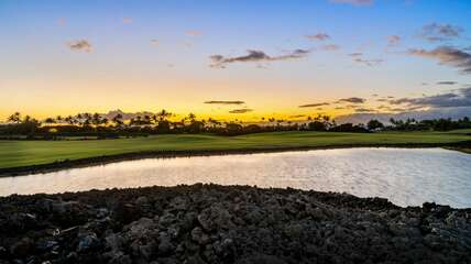 Overlooking the golf course pond at sunset