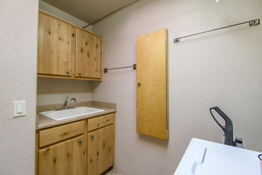 Laundry Room with Sink and Wall Unit Ironing Board