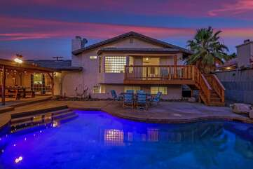 The spacious backyard is made to entertain, the large pool will be the highlight of your trip.