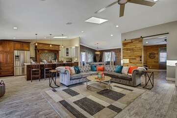 As you enter, you are greeted with a large open floor plan.  The gourmet kitchen and spacious living are made to entertain.