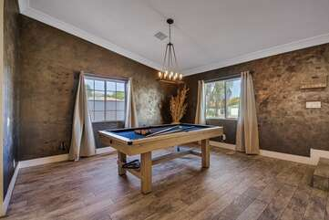 Located just inside the front door, the great pool table!