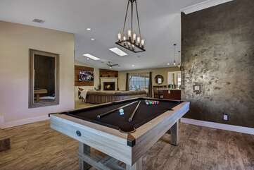 Challenge a friend to a game of pool, winner gets to pour the drinks at the bar, located across from the living space.