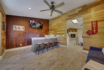 Enjoy each others company in the bar with seating for four and a 50-inch TCL Smart television.
