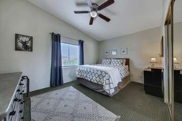 Bedroom 3 is located across from the Master Suite. Featuring a Queen-sized Bed and 50-inch Samsung HDTV television with Roku stick.