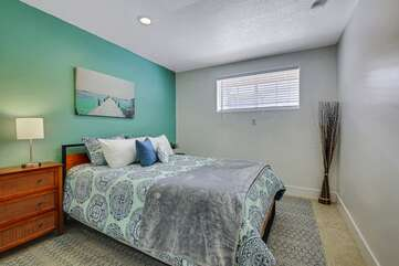 Bedroom 5 is located next to Suite 2 and features a Queen-sized Bed.