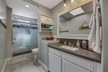 Hallway bathroom 3 is located upstairs and features a tile shower and sink.