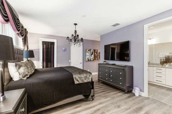 The room features a king-sized bed, large TV, and spooky details