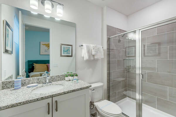 The ensuite bath has a walk-in shower
