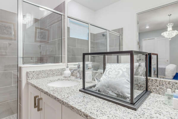 Get ready at the dual vanity with large mirror and great lighting