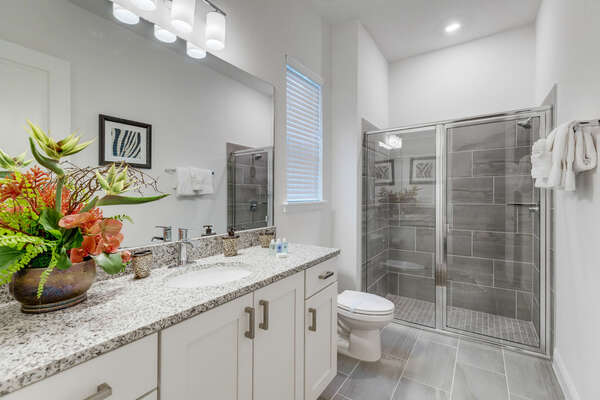 The large ensuite bathroom has a large vanity perfect for getting ready at