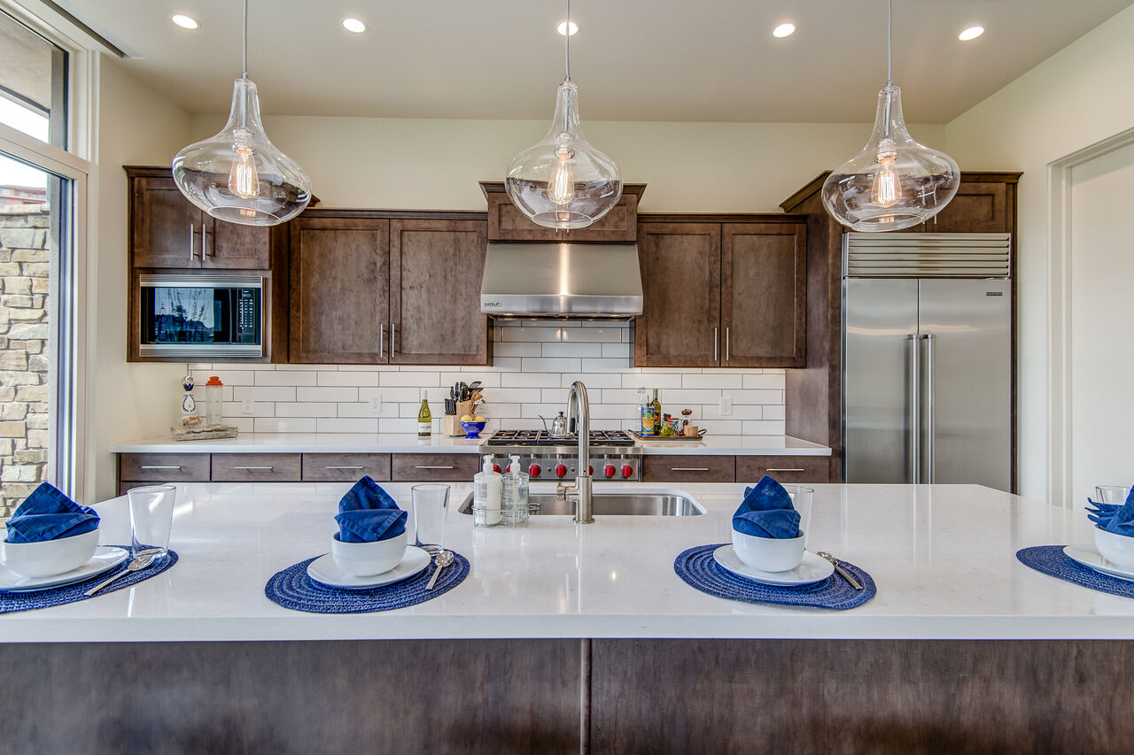 Spacious Gourmet Kitchen with Stone Counters and High-end Appliances