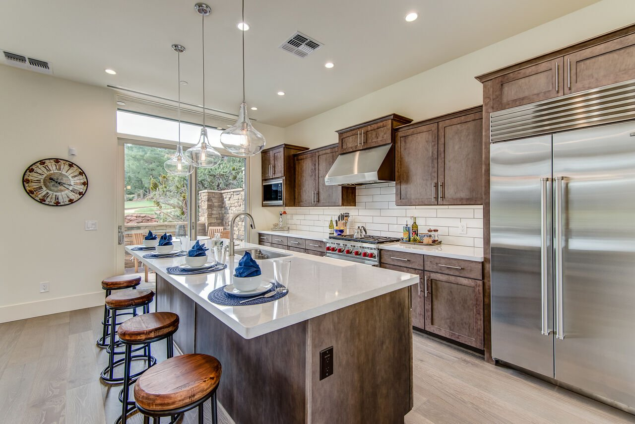 Fully Equipped Gourmet Kitchen with a Large Center Island with Seating for Four