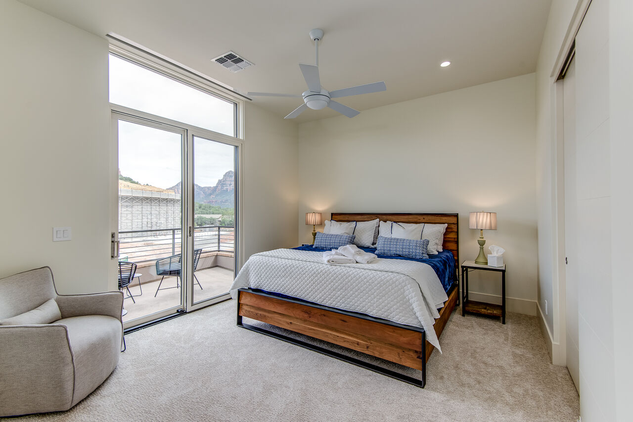 Upper Level Bedroom 2 with a King Bed and Full Shared Bath Access