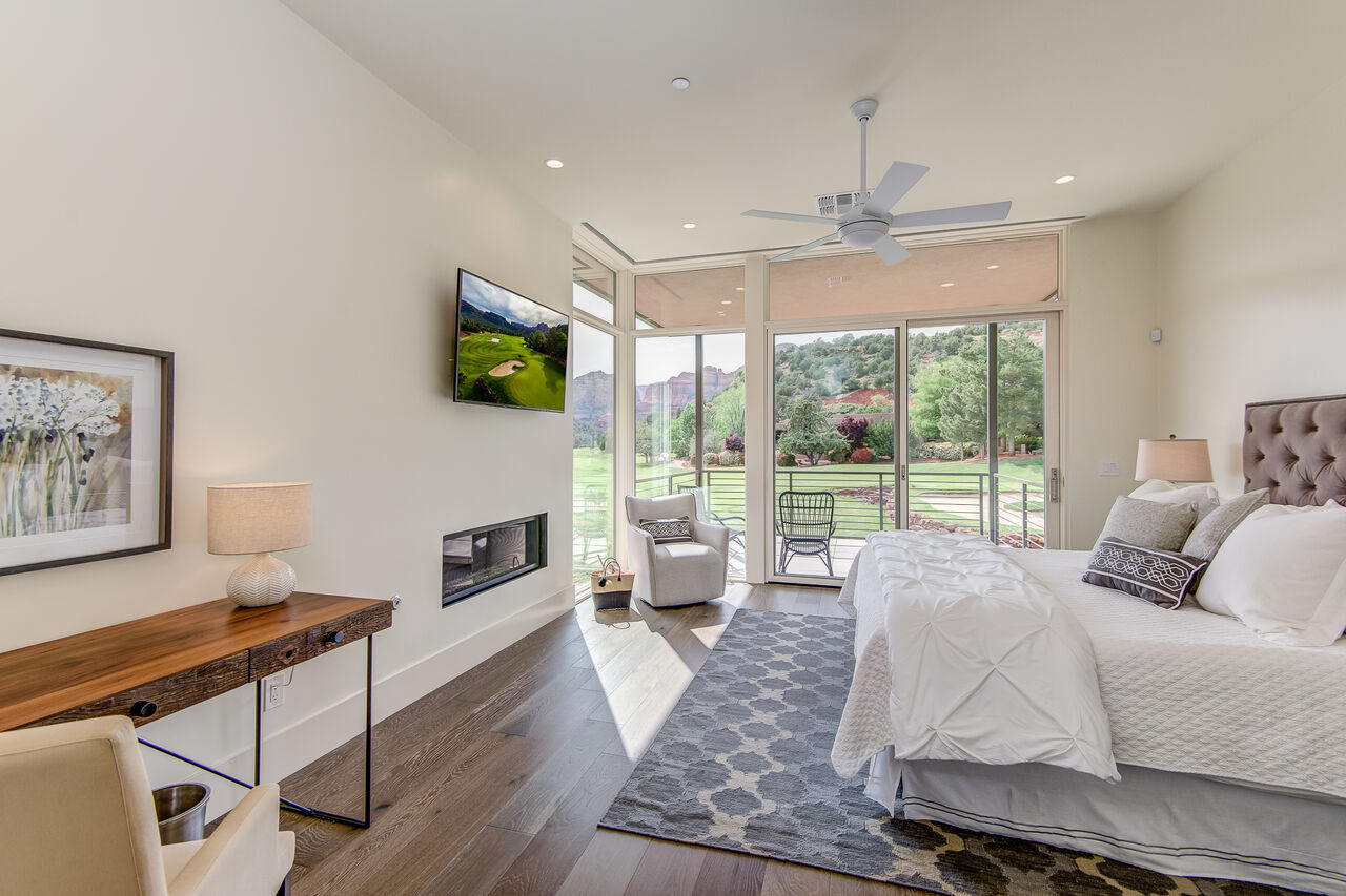 Upper Level Master Bedroom with a Gas Fireplace, 50