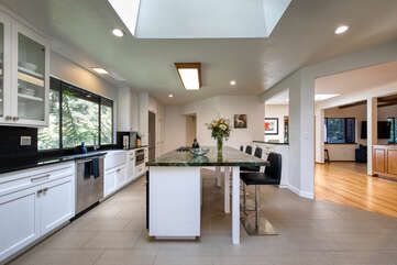 Well-equipped kitchen opens onto den and dining area