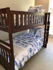 Twin bunk beds with en suite bath and separate entrance