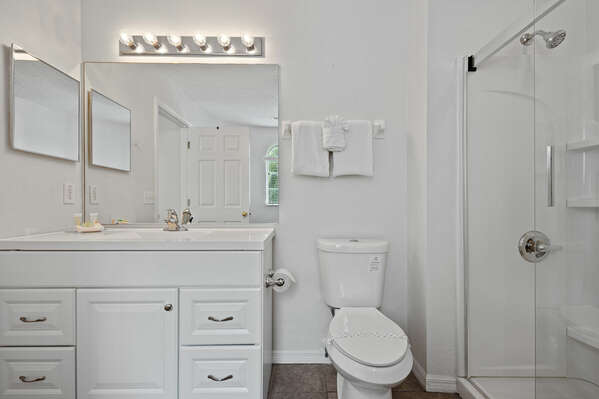 The ensuite bathroom comes with a walk-in shower.