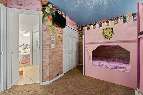 Watch a fairytale on the wall-mounted TV before bedtime.