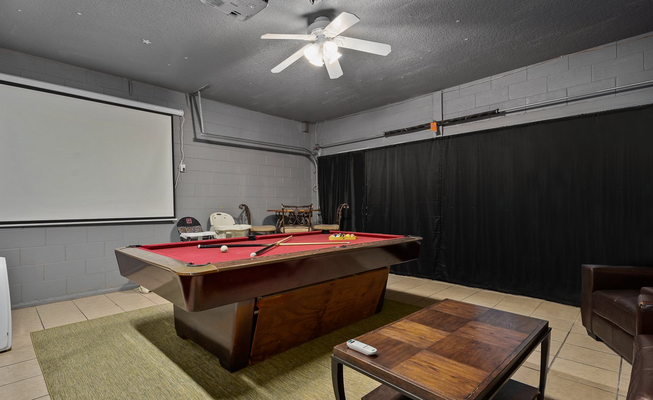 The garage was converted to a game room with a projector and wall canvas.