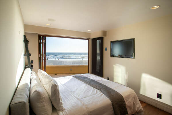 Large TV Mounted on Wall of Bedroom.