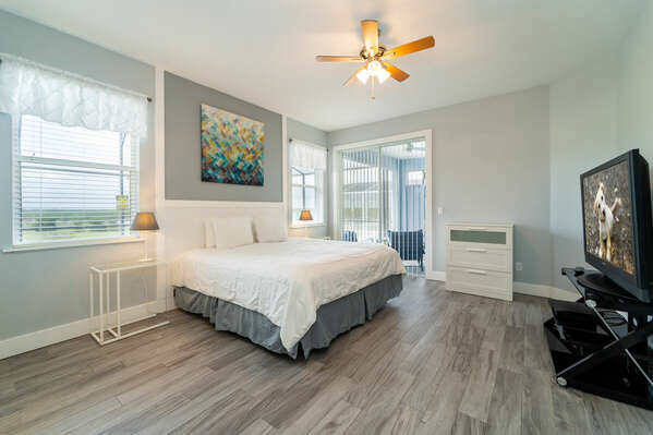 Master bedroom with king bed, patio doors to pool area and flat screen TV (downstairs)