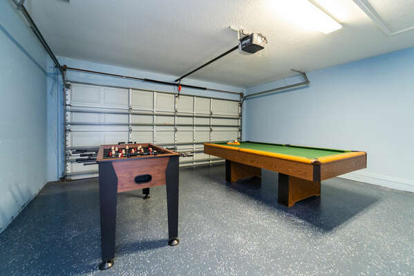 Garage converted to games room with foosball and pool table