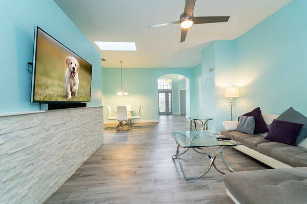 Family seating area with wall mounted flatscreen