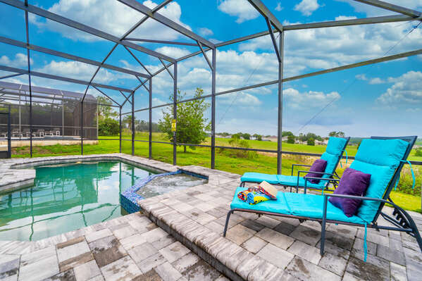 Relax on a sunlounger beside the pool which overlooks the golf course