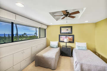 Upstairs loft bedroom with twin beds