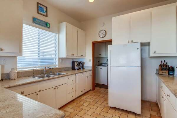 West Fully Stocked Kitchen with fridge and sink