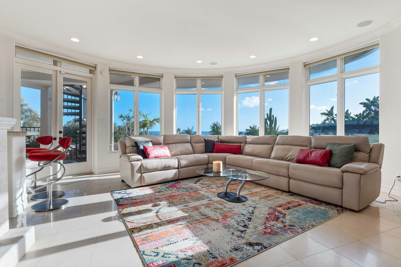 Entry level living area with full wet bar and ocean view