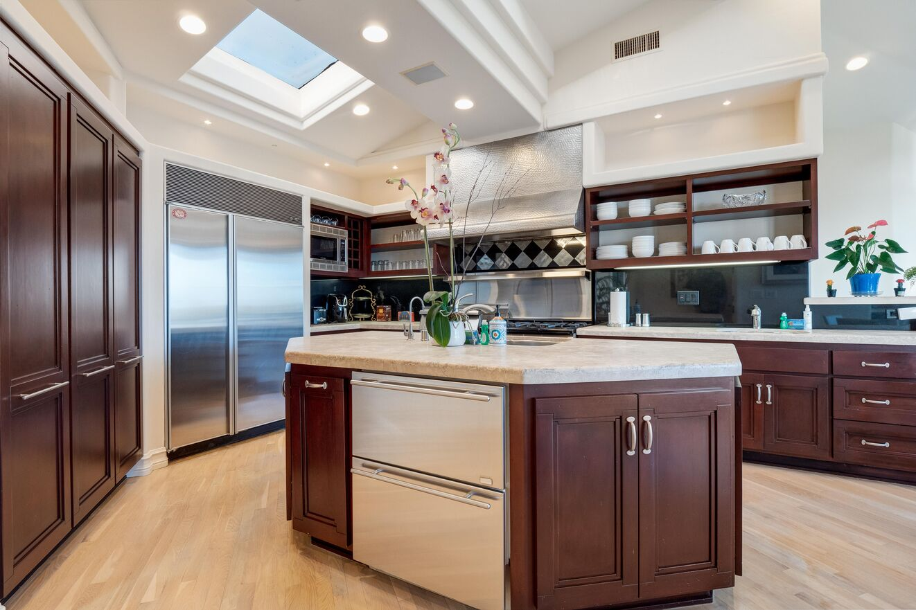 Kitchen with professional grade appliances on top floor