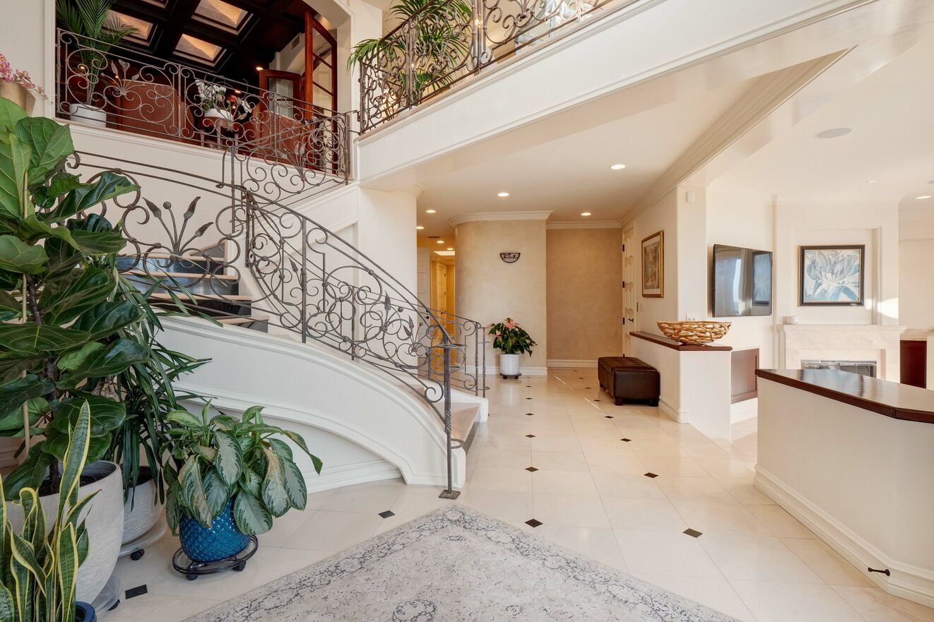 Entry level with living area, wet bar, elevator access and 4 bedrooms with ensuite bathrooms.